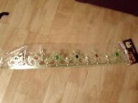 Kids plastic crown with coloured jewels. New in packaging.