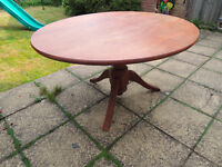 Oval, teak folding, dining table easily sits six