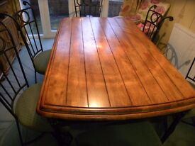 Honey pine dining table and six chairs