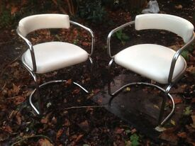 PAIR OF CHROME RETRO CHAIRS WITH WHITE FAUX LEATHER COVERING