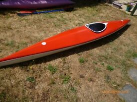 KAYAK, RED AND WHITE, WITH PADLE
