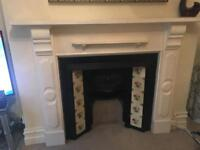Original Cast Iron Victorian Fireplace with wooden surrounding mantelpiece.