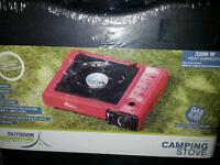 Camping stove with free gas canister