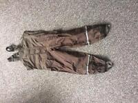 Waterproof trousers with suspenders