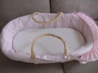 Moses Basket with additional soft mattress.