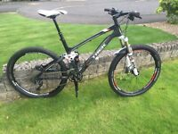 Trek Fuel EX 9.7 carbon full suspension mountain bike. Very clean, with dropper post & hope wheel.