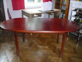 Extendable oval dining table with four chairs