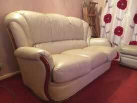 Cream three piece suite for sale. Settee excellent. Chairs had more wear. Also pouffe