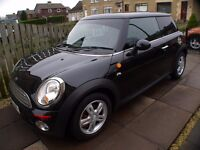 Immaculate Mini First late sept model 2009 with very low miles in pearl metallic black
