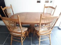 Solid wood extendable table. 4 chairs.
