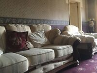 3 piece suite for sale cream in colour with teak effect wood feet. £100. Buyer to collect.