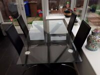 Glass table with 4 chairs for sale