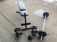York bench - dumbell set and barbell with weights