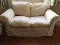 Cream patterned 2 seater sofa £75 ono