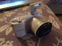 Samsung NX 2000 white smart camera kit with 64 GB Card rarely used
