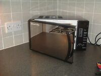 Microwave oven. Russell Hobbs. LIke brand new. Bargain. Selling at Argos for £89.99
