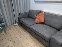 Grey large used sofa