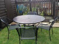 Lovely black gloss metal round garden table and four chairs