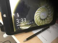 Acer Iconia W3 - 810 tablet in leather case and stylus.