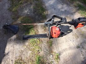 FLYMO PETROL STRIMMER AND HEDGE TRIMMER. GOOD COMPRESSION, NOT ATTEMPTED TO START THEM,SPARES/REPAIR