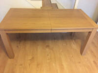 Large extendable Real Oak Veneer Dining Table. Only couple of months old.