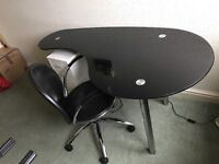Stylish glass desk with chrome legs. Comes with adjustable office chair