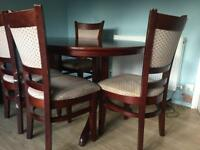Mahogany extendable dining table with chairs