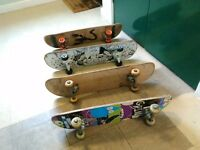 4 used skateboards