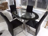 For Sale Glass topped Dining table and 4 dining chairs