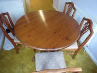 Ducal Pine round (but extendable) dining table and 4 upholstered Ducal chairs.
