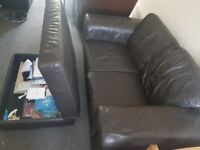 2 seater quality leather sofa and large footstool/ottomon/ large storage space inside