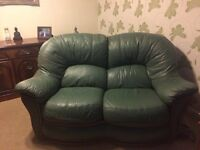 Green leather two seater sofa with single chair. Good condition. Buyer to collect by 23rd March