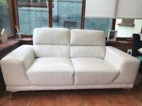 Faux leather white sofa.)