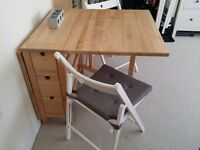 Folding Table and x4 white folding chairs