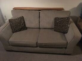 Two seater sofa and poof in excellent condition