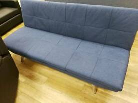 Navy sofabed with metal legs pulls and clicks up and down to make sofa and bed