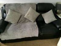 Black leather reclining 3 seater sofa