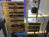 Xbox 360 slim + kinitic + 33 games + driving controller & 2 controllers & charger + headset + remote