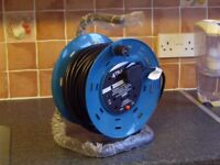 BRAND NEW CABLE REEL , 4 GANG , 240 VOLT , 25 MTRS ( 82ft ) IN LENGTH AND 13 AMP .