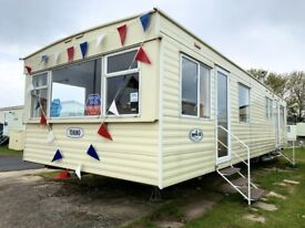 Cheap static caravan for sale sited in Essex includes 2021 pitch fees