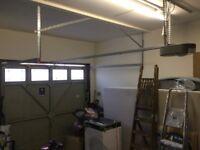Electric Garage door mechanisms & one garage door.