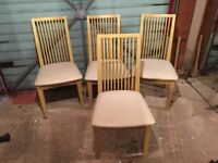 Oak dining chairs with cream seat pad