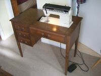 Singer Futura 1100-series electric sewing machine with table