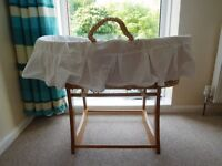 mothercare baby bassinet on a wooden rocking stand