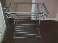 2 wrought iron side tables with class tops