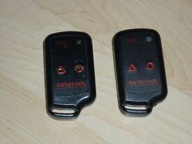 Datatool Veto Evo pair of motorcycle alarm transmitters.