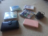Nintendo ds lite with 4 games and a case