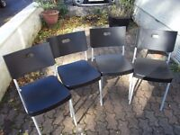 Ikea black plastic & steel kitchen chairs, set of four.