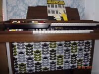 Electric Piano, Yamaha Electone Organ with Orla Kiely fabric and lots of books
