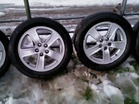 4 genuine toyota 16in alloys 5 x 100 with tyres/centre caps